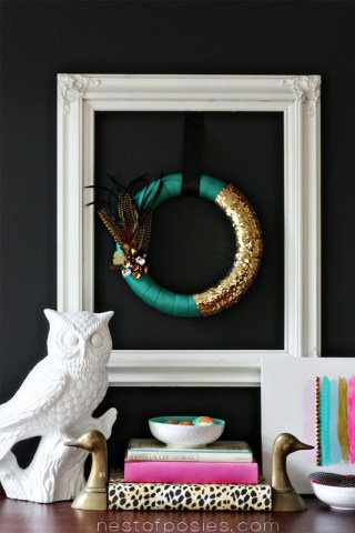 Come see how easy it is to make this Pantone Green Fall Feather Wreath via Nest of Posies