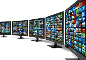 Row of widescreen HD displays wtih multiple images isolated on white background