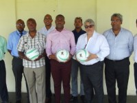 Deputy PM Hon. Shawn Richards (5th from left), PS Christopher Herbert (2nd from left), Ambassador Jonel Powell (4th from left) and other members of the Department of Sports along with Uday Nayak, (3rd from right), Richard Berridge (4th from right) and other members of the St. Kitts and Nevis Patriots.