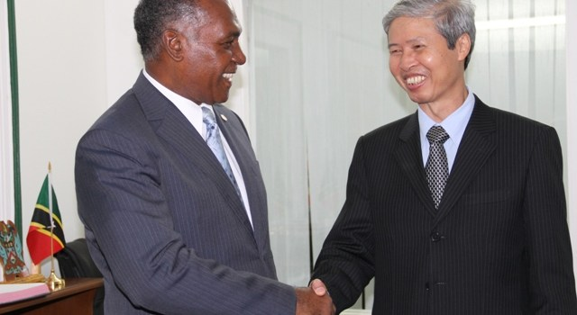 (l-R) Premier of Nevis Hon. Vance Amory welcomes the first Vietnamese Ambassador to St. Kitts and Nevis His Excellency Mr. Duong Minh during a courtesy call at Bath Hotel on November 24, 2015