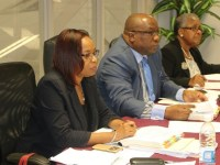 Prime Minister Dr. the Honourable Timothy Harris (centre) flanked by Financial Secretary, Hilary Hazel (left) and Cabinet Secretary, Josephine Huggins (right)