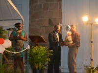 Premier of Nevis Hon. Vance Amory presents Patron of the Charlestown Christmas Tree Lighting Ceremony Steven Hanley with a gift basket, for his outstanding contribution to the community