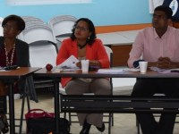 (From left to right) Drs. Birchwood, Singh Minott and Krishnamurthy pay rapt attention during the training