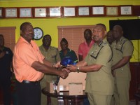 Mr Othniel Hyliger presenting a gift of 10 emergency vehicle lights to Commissioner of Police Ian Queeley copy 2