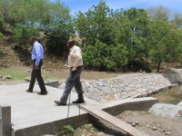Deputy Premier of Nevis and Minister of Tourism Hon. Mark Brantley (l) and Permanent Secretary in the Ministry of Tourism Carl Williams touring ongoing works at the Bath Stream on June 28, 2016