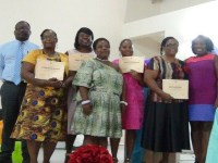 Sewing class graduates and officials