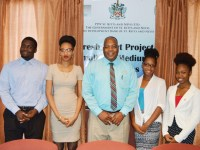 General Manager, Development Bank of St. Kitts and Nevis, Mr Lenworth Harris (centre), with CFBC interns, from right: Ms Samantha Hodge, Ms Chamique Phipps, Ms Kaedida Fough, and Mr Aziel Smithen.