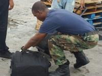 Police conducting bag checks at Charlestown Ferry Terminal during Culturama.