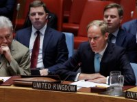 UK ambassador to the UN Matthew Rycroft (L) speaks with US enoy Samantha Power (R)before a Security Council meeting on Sunday 25 September in which both walked out when the Syrian representative was about to speakReuters
