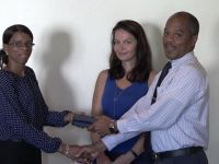 Hospital Administrator at the Alexandra Hospital Gary Pemberton hands over equipment for use at the Paediatric Ward to Paediatrician Dr. Cloe Smithen.  Carolyn Chisholm, Treasurer of the Paediatric Assistance League of St. Kitts and Nevis (middle) looks on moments after she handed over the gift to Pemberton at the hospital's conference room on October 18, 2016