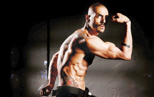 arjun rampal flexing his biceps