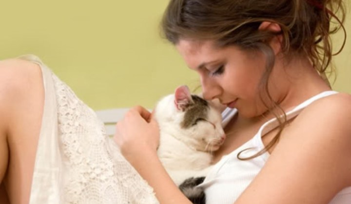 woman cuddling a cat_New_Love_Times