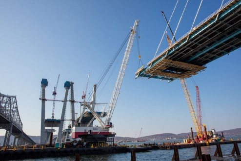 November 16, 2016 - The main span roadway continues to grow with the assistance of mobile, barge-based cranes.