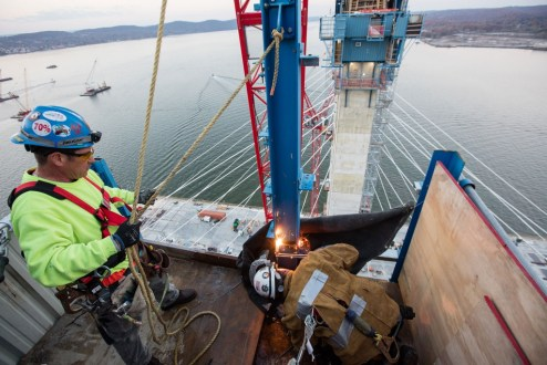 November 16, 2016 - Workers remove sections of the project's blue jump forms as the towers reach their final height 419 feet above the Hudson River.