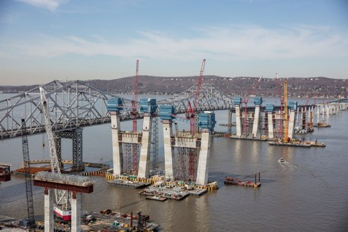 April 6, 2016 – Blue jump forms act as mobile work spaces as the new bridge's towers continue to grow.