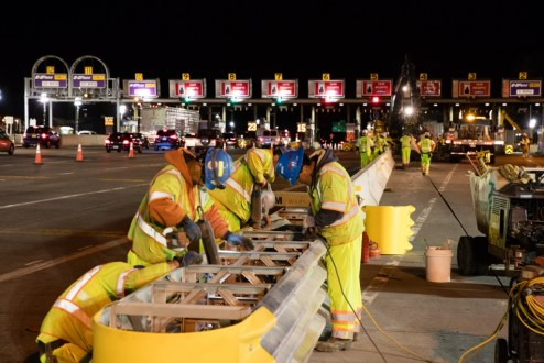 April 23, 2016 - Workers modify a road barrier near the Tarrytown toll plaza in preparation for a new lane configuration.