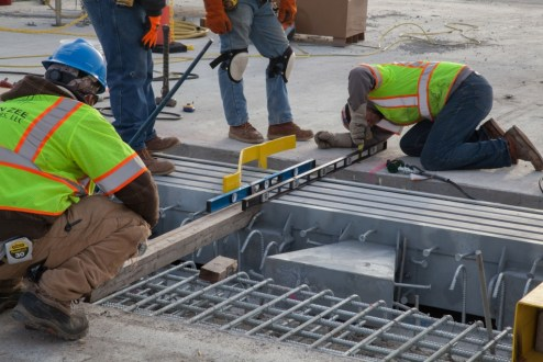 December 13, 2016 - Workers measure the placement of an expansion joint, ensuring a precise connection to the roadway.