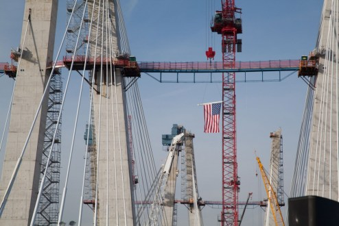 December 13, 2016 - The project team raises a flag on the main span.