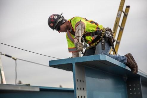 December 15, 2017 - An ironworker adjusts a steel girder connection.