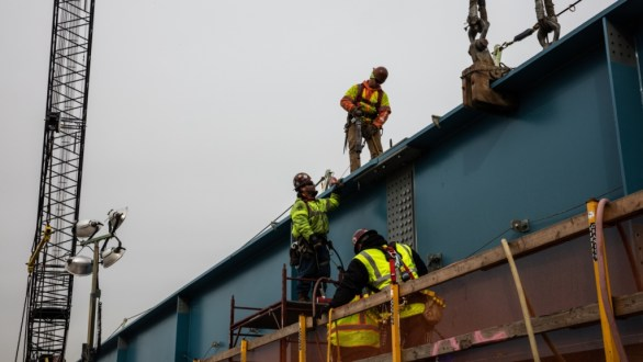 December 15, 2017 - Ironworkers connect two steel girders into a larger assembly.