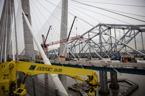 December 15, 2017 - The project team lowers the last red tower crane on the main span.