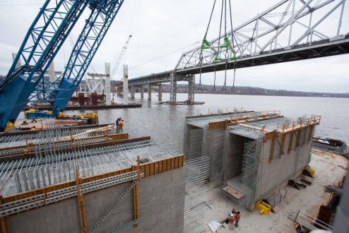 February 8, 2016 - Precast crossbeams are prepared for installation on the main span.