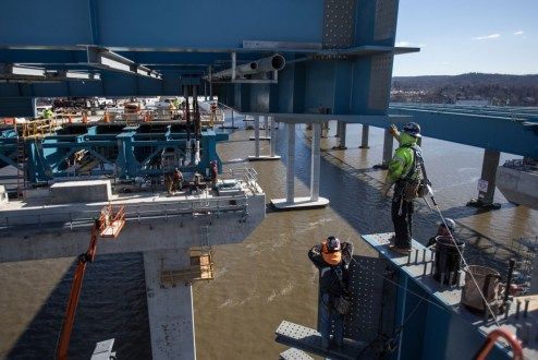 February 4, 2017 - Workers oversee the lowering of a structural steel section on the main span.