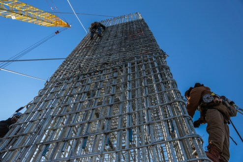 January 7, 2016 - Ironworkers tie an enormous rebar cage for a new bridge pier column.