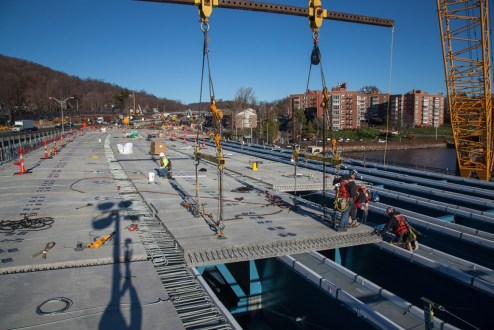 December 16, 2015 - The new road deck panels rest atop the previously installed steel-blue girders.