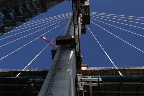 November 28, 2016 - Crews use a temporary elevator to access the 419-foot main span towers.