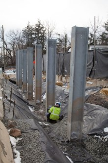 December 21, 2016 - A worker inspects the steel foundations for a noise reducing barrier in Rockland County.