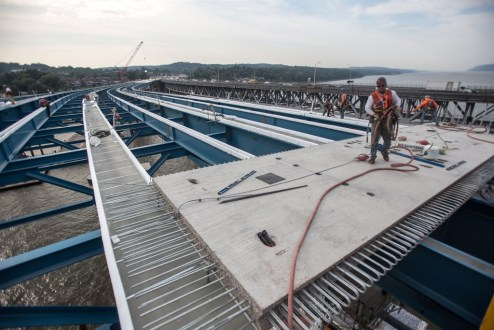 July 22, 2016 - Precast road deck panels are placed on the new bridge's Westchester approach.