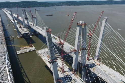 June 9, 2017 - New sections of the main span roadway will be installed with barge-based cranes.