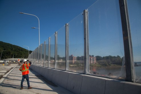 June 28, 2017 - Transparent noise barriers are installed on the northern end of the westbound span.