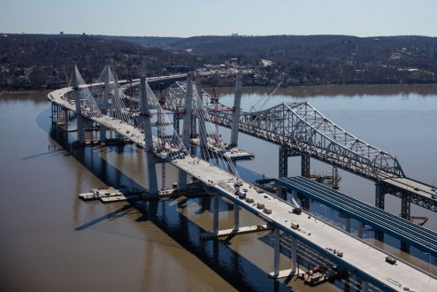 April 9, 2017 - Workers continue to install support structures, including expansion joints and concrete barriers on the main span.