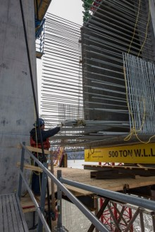 March 6, 2016 - An ironworker checks the steel reinforcements of a 750-ton crossbeam.