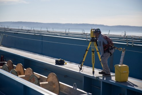 March 16, 2016 – Surveyors ensure that bridge materials are properly aligned.