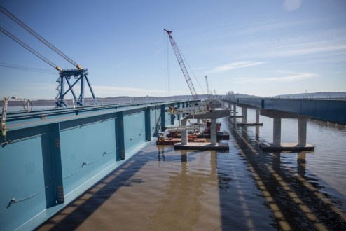 March 16, 2016 – The new westbound bridge is prepared for another assembly of steel girders.