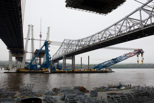 May 1, 2017 - The I Lift NY super crane passes underneath the new bridge that it helped create.