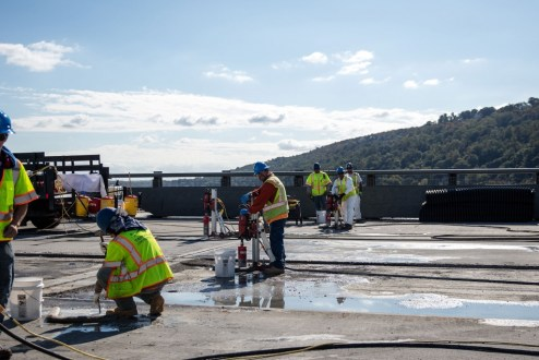 October 12, 2017 - Workers prepare the old bridge's concrete road deck for removal.