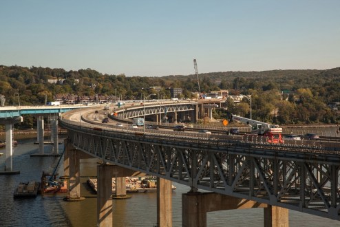 October 6, 2017 - Construction vehicles prepare for the shift of eastbound traffic from the old bridge to the new structure.