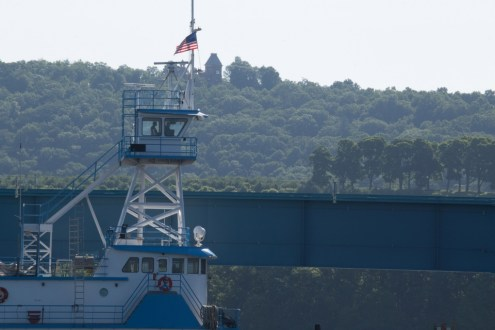 June 10, 2015 - The captain of the Ocean Tower pilots the tugboat from the upper control room.