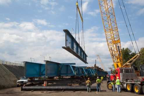 October 8, 2015 - Individual girders are joined together into larger assemblies before their installation from the Westchester abutment.