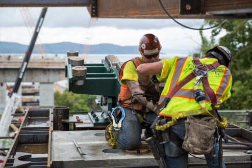 September 30, 2015 - Ironworkers prepare a specially-designed track system that will help move massive assemblies of steel from the Westchester abutment.
