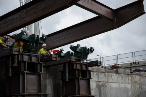 September 30, 2015 - Ironworkers make adjustments to the track system that will help guide the installation of the girder assemblies from the Westchester abutment.