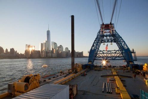 October 6, 2014 - I Lift NY passes One World Trade Center on its way to the project site.