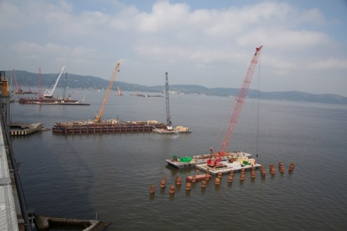 September 5, 2014 - Some of the nearly 30 barge mounted cranes performing operations near the main span.