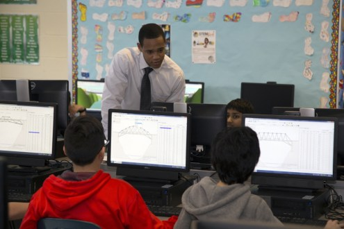 February 10, 2015 - Critiquing Anne M. Dorner Middle School students on their bridge designs for the 2015 Engineering Encounters Bridge Design Contest.