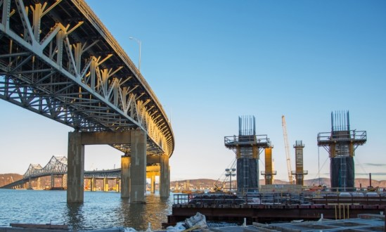 March 31, 2015 - Pier columns for the new twin-span crossing rise alongside the existing Tappan Zee Bridge.