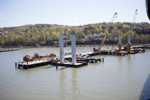 March 31, 2015 - A pair of completed pier columns stand alongside a temporary wor